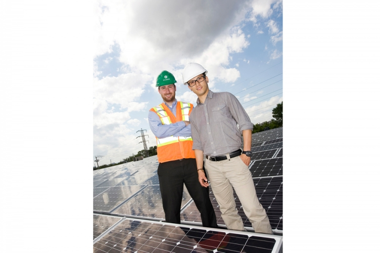 2 men with solar panel roof