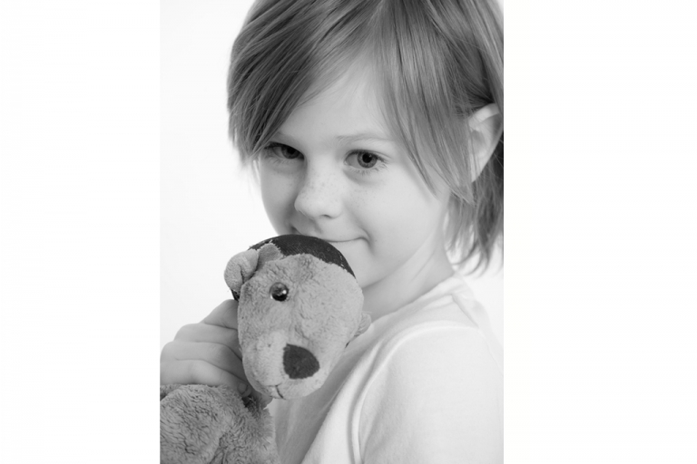 Young boy with teddy bear