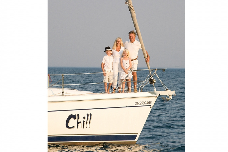 Family portrait on a Yacht - sail boat - on the lake